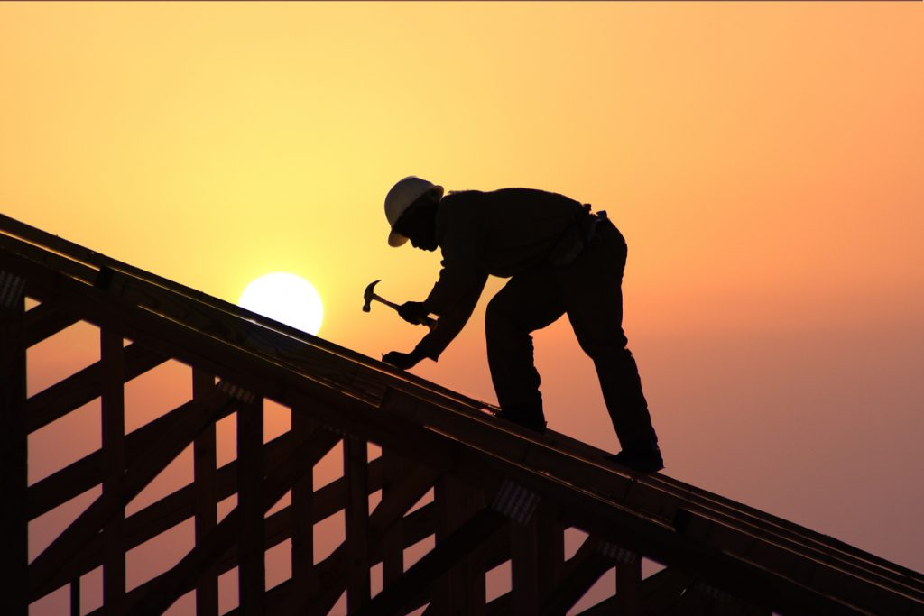 Carpentry roofer working on a home roof