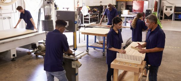 Carpentry workshop with students and a teacher